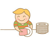 Boy drying dishes Stock Photography