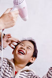 Boy drying hair. Picture of a little chinese boy drying hair with a cheerful expression Stock Image