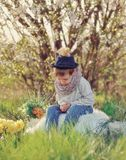 The boy with ducklings Stock Image