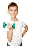 Boy with dumbbell. Boy making exercises with a dumbbell on a white background Stock Photos