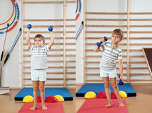 boy with a dumbbell Stock Images