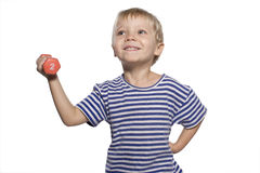 Boy with dumbbell Stock Images