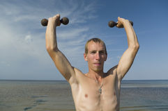 Boy with dumbbells. Royalty Free Stock Images