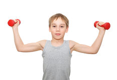 Boy with dumbbells. Young Caucasian boy with dumbbells on white background Stock Photos