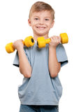 Boy with dumbbells Royalty Free Stock Images