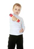 Boy with dumbbells in hand Stock Photo