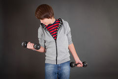Boy with dumbbells in leisure clothes Stock Photos