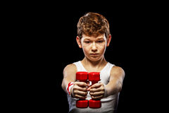Boy with dumbbells Royalty Free Stock Image