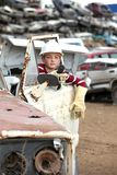 Boy at the dump cars Stock Images
