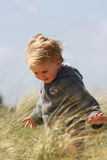 Boy in dunes Royalty Free Stock Photo