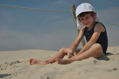 The boy on the dunes. Stock Image