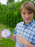 Boy and a DVD drive Royalty Free Stock Photography