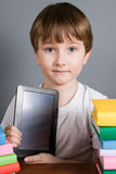 Boy with e-book Stock Images