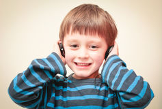 Boy with ear phones Stock Photo