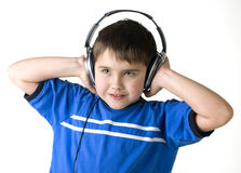 Boy in earpiecess Royalty Free Stock Photography
