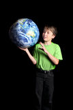 Boy Earth in his hand looks with wonder fascinatio Royalty Free Stock Photos