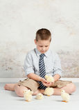 Boy with Easter Chicks Stock Photos