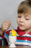 Boy and easter eggs Royalty Free Stock Images