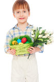 Boy with easter eggs and bunch of tulips Royalty Free Stock Photo
