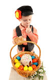 Boy with Easter eggs and a holiday cake Stock Photo