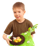 Boy and easter nest full of colorful eggs Stock Image