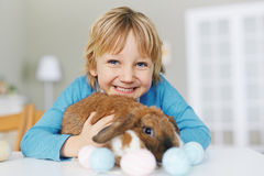 Boy with Easter rabbit Stock Photos
