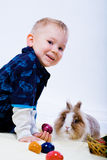 Boy and eastern rabbit Royalty Free Stock Photo