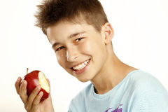 Boy eat apple. On white royalty free stock image