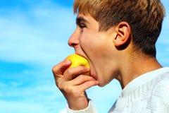 Boy eat apple stock photography