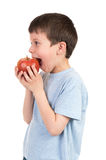 Boy eat apple isolated Royalty Free Stock Photo
