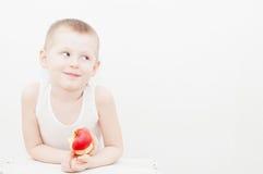 Boy eat apple Royalty Free Stock Photos