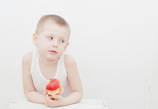 Boy eat apple Stock Images