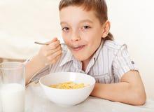 Boy eat breakfast Royalty Free Stock Image
