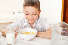 Boy eat breakfast at home Stock Photos