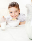 Boy eat breakfast at home Royalty Free Stock Image