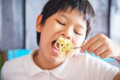 Boy eat delicious cream sauce spaghetti royalty free stock images
