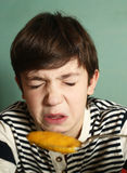 Boy eat pumpkin soup with expression of disgust Stock Photos