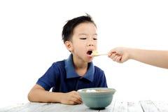 Boy eat rice Royalty Free Stock Photos