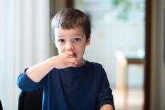 A boy eat some bread stock photos