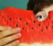 Boy eat water melon close up portrait Royalty Free Stock Image