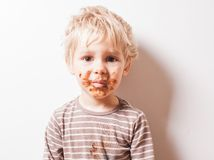 Boy eated chocolate and have dirty face royalty free stock photography