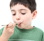 Boy Eating Stock Image