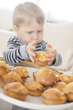 Boy eating. Boy holding a cake in his hands Royalty Free Stock Photo