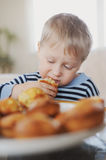 Boy eating stock photography