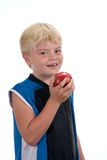 Boy eating apple. Smiling young boy about to eat an apple shot over white Stock Photos