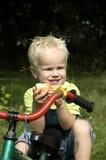 Boy eating an apple. Cute boy eating an apple royalty free stock photos