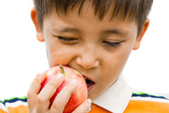 A boy eating an apple Royalty Free Stock Photos