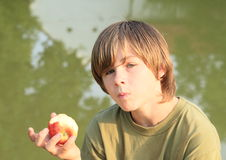 Boy eating an apple Stock Image