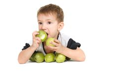 Boy eating apples Royalty Free Stock Image
