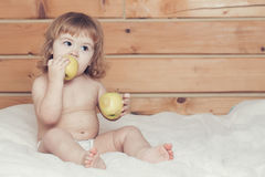 Boy eating apples Stock Photos